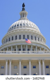 View of the United States Capitol building dome and American flag.