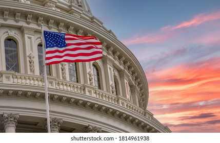 View of the United States Capitol Rotunda Dome in Washington DC with the Star Spangled American Flag against colorful dramatic sunset sky background