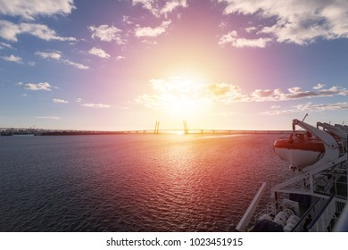 View from upper deck of cruise liner on bridge and landscape with sea and blue sky