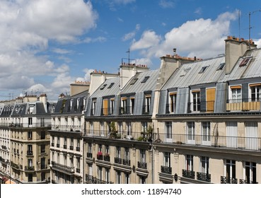 View of upper floors and rooftops of street and apartments in Paris in the Latin Quarter
