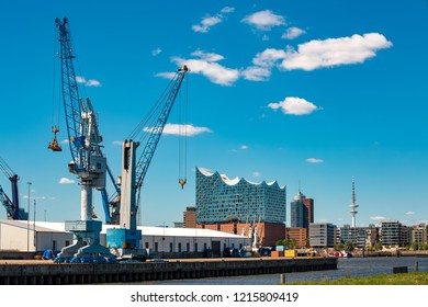 View of the upper harbor in Hamburg with Elbphilharmonie and harbor cranes