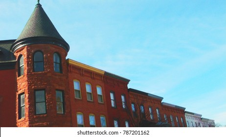 View of the upper portion of a group of rowhouses in Baltimore's Bolton Hill neighborhood.