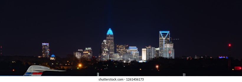 View of uptown downtown Charlotte, North Carolina skyline at night as seen from the CLT Airport