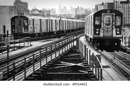 View of an uptown and downtown elevated subway trains.