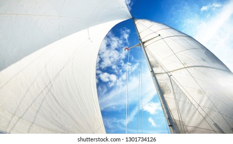 View upwards to the mast of a sailboat on a summer day