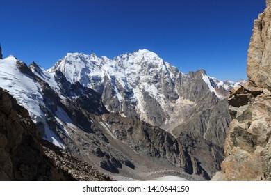 View from the Ural mountain pass to Dykh-tau mountain, Pushkin peak, Mingirge mountain