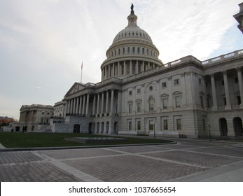 View of the US Capitol Building in Washington, D.C. with clouds in the background