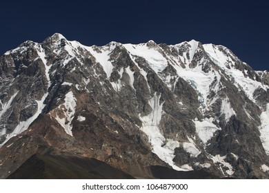 View from Ushguli on the massive wall of the third highest peak of the Caucasus 5,197 meters Shkhara.North Svaneti.Georgia.Asia