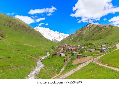 View of the Ushguli village at the foot of Mt. Shkhara. Picturesque and gorgeous scene. Rock tower in Ushguli - the highest inhabited village in Europe