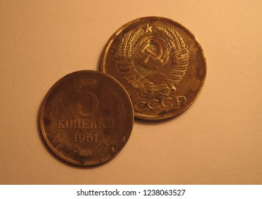 View of USSR coin. Kopecks from Soviet Union. Great for numismatic collection. Shiny coin isolated on yellow surface of paper. Historical old retro coin of kopek (cent).