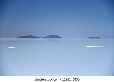 A view from Uyuni salt flats which is covered by a few meters of salt crust and thin water layer, Bolivia.