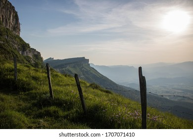 View of Valle de Mena and Valle de Losa, in Burgos, North of Spain. Green valley a sunny day with rugged mountain ridge. Meadows and forests.