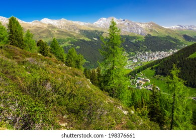 View to Valley with Davos city surrounded by Swiss Alps from the top of the Rinerhorn mountain, Grison, Switzerland
