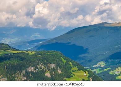 View of a valley with forest on the mountain slopes