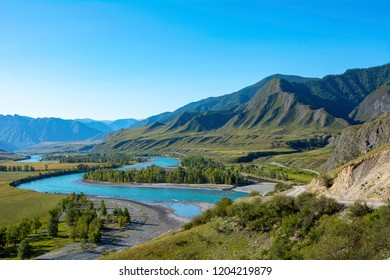 View of the valley of the Katun river and Inegen village, a cluster of Argut in the Altai Republic