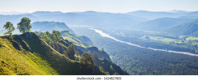 View of the valley and the Katun River from the mountain, Altay. Spring panoramic view.