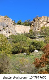 View from the valley on the cavetown Chufut-Kale in the autumn near Bakhchisarai city on the Crimean Peninsula. It'is a medieval city-fortress in the Crimean Mountains that now lies in ruins.
