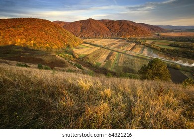 view of a valley over hills in autumn