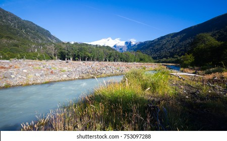 View from valley of river Cauquenes to mountain Tronador and glacier on summer day. Patagonia, Argentina