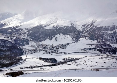 View to valley, St. Moritz from peak Muottas Muragl in the Engadine, canton of Graubunden, Switzerland. January 2018.