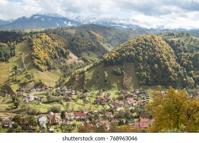 View of the valley with the villages at the foot of the Carpathian Mountains not far from the city of Bran in Romania