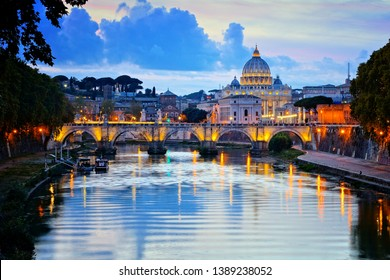 View of Vatican City and St Peters Basilica across the River Tiber at dusk, Rome, Italy