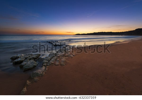View of the Vau Beach (Praia do Vau) at sunset in Portimao, Algarve, Portugal; Concept for travel in Portugal and Algarve