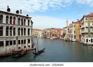 The view of Venice old town with gondolas sliding through Grand Canal (Italy).
