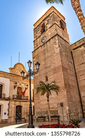 View of Vera church tower and town hall building on Main square, in the province of Almeria, southern Spain.
