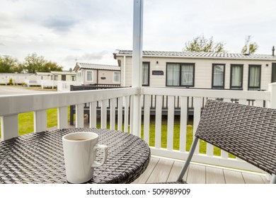 View from veranda on static caravan with bistro table and chair in the foreground at a holiday Park in Prestatyn, North Wales, United Kingdom.