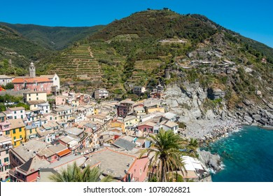 View of Vernazza from the castle tower with the secret beach on the left and mountains covered with vineyard