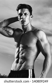 View of a very fit male model with muscles.Fashion photo.Fine art.