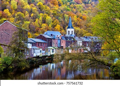 View of Vesdre river and church of Saint Francois Xavier in Belgian town of Chaudfontaine, Wallonia