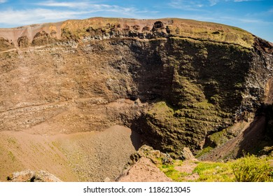 View of Vesuvius volcano crater. Crater seen from the inside, frozen lava, magma, rock and blue sky. Martian landscape near Naples, Italy. Beauty of nature, inactive crater, long time after eruption.