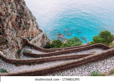 View of Via Krupp. It's a historic switchback paved footpath on the island of Capri, connecting the Charterhouse of San Giacomo and the Gardens of Augustus area with Marina Piccola.