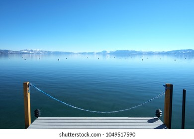 View of vibrant blue Lake Tahoe from the Nevada side towards California.
