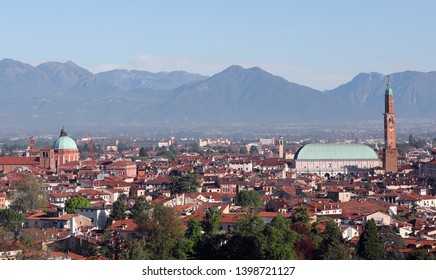 view of Vicenza with Basilica Palladiana in the foreground and the mountains in the background