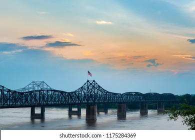 View of the Vicksburg bridge over the Mississippi River at sunset