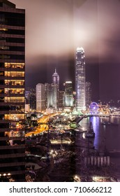 A view of Victoria Harbor from a hotel window during the light show in Hong Kong