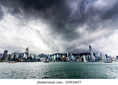 View of Victoria harbor just before a tropical cyclone  During summer, typhoons regularly skirt the city, causing varying degrees of damage including injuries and deaths