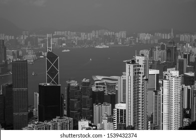 View from Victoria Peak, a mountain in the western half of Hong Kong Island to the central part of the city. It is also known as Mount Austin, and locally as The Peak. Skyscrapers and business centers