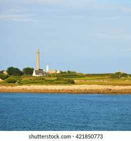 View of Ã??le Vierge lighthouse and the sea coast in Brittany, France
