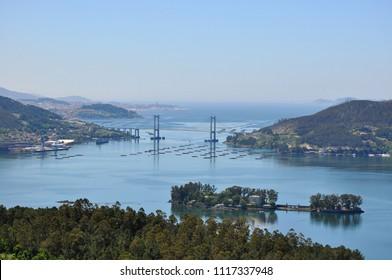 View of the Vigo bay, ria de Vigo, with San Simon island, Rande bridge, port of Vigo and Cies islands in the horizon