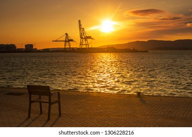 View of Vilagarcia de Arousa commercial harbor at golden sunset