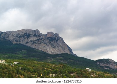 View from the village of Alupka on mount AI-Petri on a cloudy day. Crimean tourist attraction