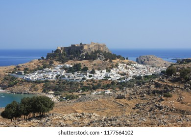 View of village, bay and Acropolis of Lindos (Rhodes, Greece)