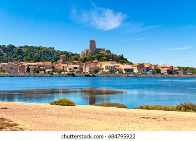 View of the village of Gruissan with the castle ruins Tour Barberousse and the pond Etang de Gruissan in southern France.