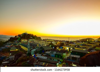 View of village at the hill at Kaiktiyo pagoda, myanmar with the golden sunrise light in the morning