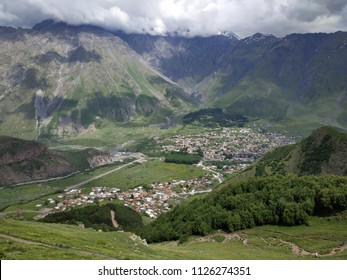 a view of the village and the mountains of Kazbek
