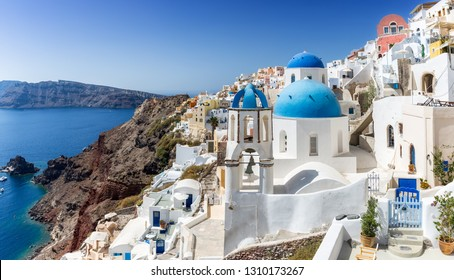 View to the village Oia with the whitewashed houses on the edge of the Volcano Caldera on Santorini island, Cyclades, Greece